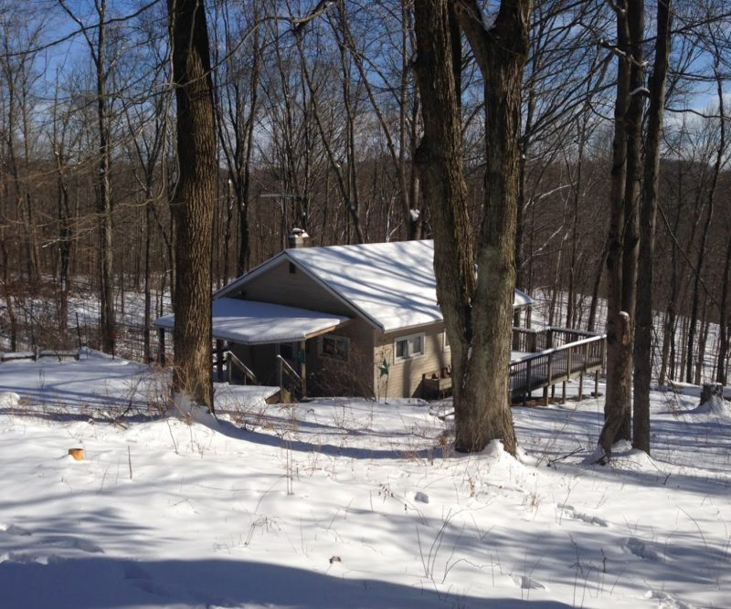 Picture of the Ravine Trail Cabin covered in snow